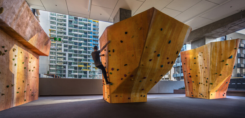 Rock Climbing Indoors with City in Windows