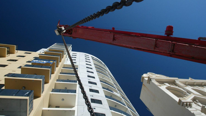 crane in front of building