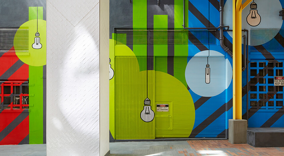 Colourful lightbulb art on building external wall